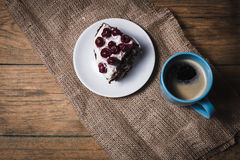 Cherry cake with coffee. On wooden background Royalty Free Stock Image