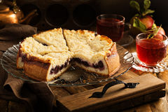 Cherry cake with crumble topping. And fruit tea Royalty Free Stock Photos