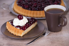 Cherry cake with a cup of coffee Stock Image