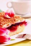 Cherry cake and flowers. Stock Photos