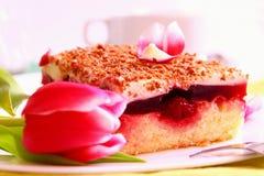 Cherry cake and flowers. Stock Photo