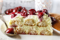 Cherry cake with lady finger biscuits Royalty Free Stock Images
