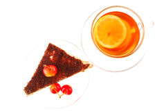 Cherry cake and tea. Cherry cake and golden tea on white Stock Image