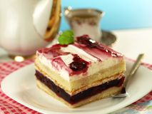 Cherry cake with tea. Cherry dessert with cup of tea Royalty Free Stock Photo
