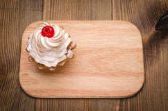 Cherry cake top view. Cherry cake on a wooden background Stock Photos