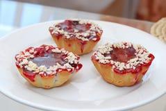 Cherry cake. Tree shaped cherry cake on white plate Royalty Free Stock Photos