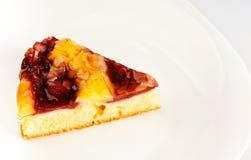 Cherry cake on white dish stock photos