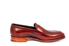 Cherry calf penny loafer shoe toe to right Stock Images