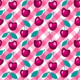 Vector Seamless pattern. Cherry on a checkered vichy background. Cherry on a checkered pink vichy background. Vector Seamless pattern royalty free illustration