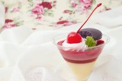 Cherry cheese cake with macaron Royalty Free Stock Photos
