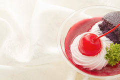 Cherry cheesecake with macaron Stock Images