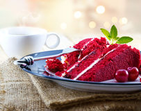 Cherry cheesecake and slices of raw cherry with mint Stock Photography