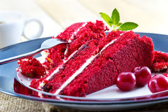 Cherry cheesecake and slices of raw cherry with mint, delicious dessert with coffee Stock Images