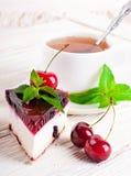 Cherry cheesecake with tea Royalty Free Stock Photos