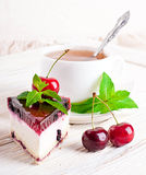 Cherry cheesecake with tea Royalty Free Stock Photography