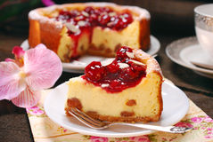 Cherry cheesecake on wooden table Royalty Free Stock Photos