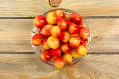 Cherry. Cherries in bowl. Fresh yellow cherry. Cherry on wooden background. healthy food concept. Berries. Fresh berries. Sweet cherry background, on a rustic Stock Photo
