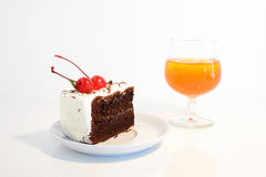 Cherry Chocolate Cake and ice tea Royalty Free Stock Photos