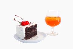 Cherry chocolate cake and Orange juice. Royalty Free Stock Photos