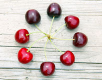 Cherry circle. Sweet cherries lying in circle on a wooden board Stock Photography