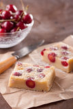 Cherry clafoutis on brown paper Stock Images