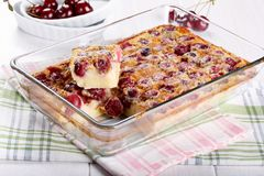 Cherry clafoutis - traditional French sweet fruit dessert stock images