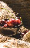 Cherry in a clay bowl Royalty Free Stock Photo