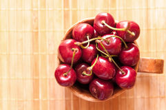 Cherry in a clay cup. Top view Stock Photos
