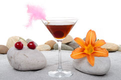 Cherry cocktail in a environment of sand and pebble stones Royalty Free Stock Images
