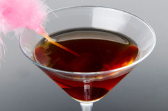 Cherry cocktail on a gray background Stock Images