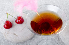 Cherry cocktail on a sand background Stock Image