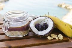Cherry coconut banana overnight oats stock photography