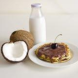 Cherry coconut pancakes stock image