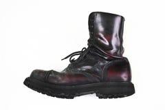 Cherry combat boot. Dusty combat boot on white background Stock Photo