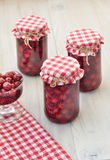 Cherry compote. Homemade sweet ripe cherries in vintage jars Stock Photography