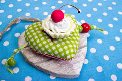 Cherry cookie on heart. Cherry cookie on green heart Royalty Free Stock Photography