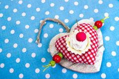 Cherry on red heart. Cherry cookie on red heart Royalty Free Stock Photography