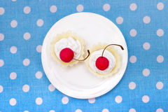 Cherry cookies. Delicous cherry cookies served on white plate. Top view Stock Photos