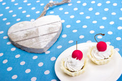 Cherry cookies and heart. Cherry cookies on white plate with wooden heart Stock Photo