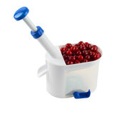 Cherry corer with cherries Royalty Free Stock Photography