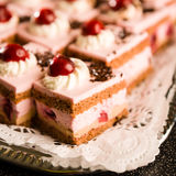Cherry cream filled sponge cakes with topping Stock Photo