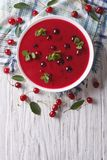 Cherry cream soup with mint. vertical top view Stock Photo