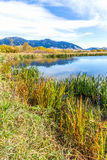 Cherry Creek Preserve. A beautiful reservoir in autumn fields at the foot of the Bridger mountain range in Cherry Creek Nature Preserve on the outskirts of Stock Photos