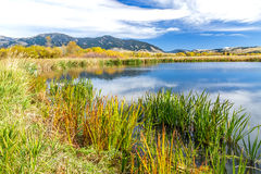 Cherry Creek Preserve. A beautiful reservoir in autumn fields at the foot of the Bridger mountain range in Cherry Creek Nature Preserve on the outskirts of Royalty Free Stock Photo