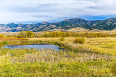 Cherry Creek Preserve. A pond in beautiful autumn fields at the foot of the Bridger mountain range in Cherry Creek Nature Preserve on the outskirts of Bozeman Royalty Free Stock Image
