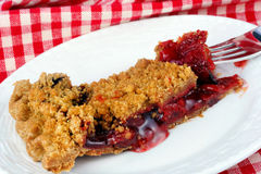 Cherry Crumb Pie. One slice of homemade cherry crumb pie on an angle stock images