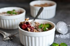 Cherry crumble with nuts and mint stock photos
