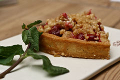 Cherry crumble pie. With fresh mint leaf Stock Images