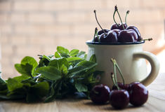 Cherry in cup on wooden table. Cherry in cup on wood Stock Photo