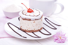Cherry cupcake on white wooden table Stock Photography